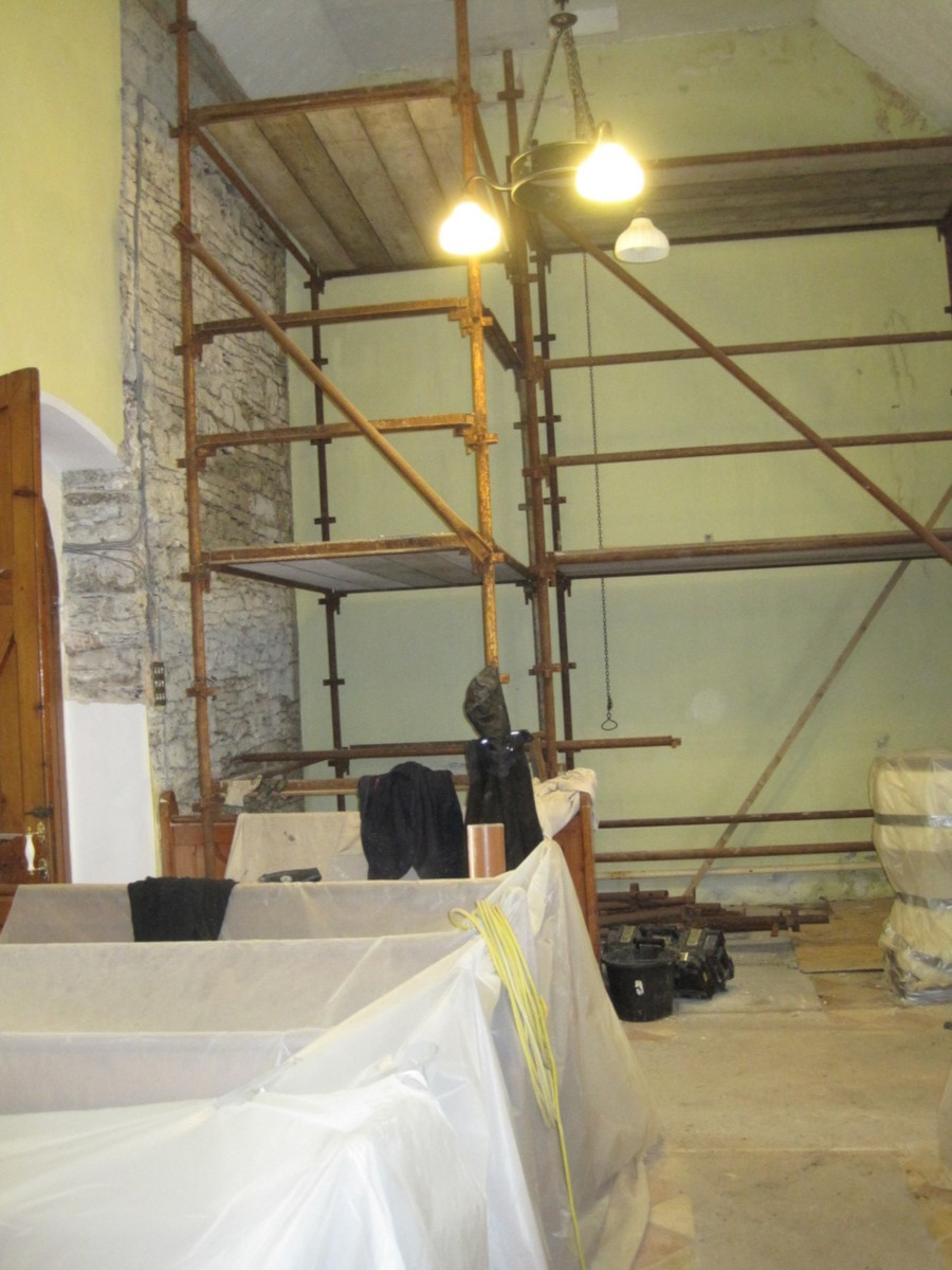 Removing plaster from the west wall.