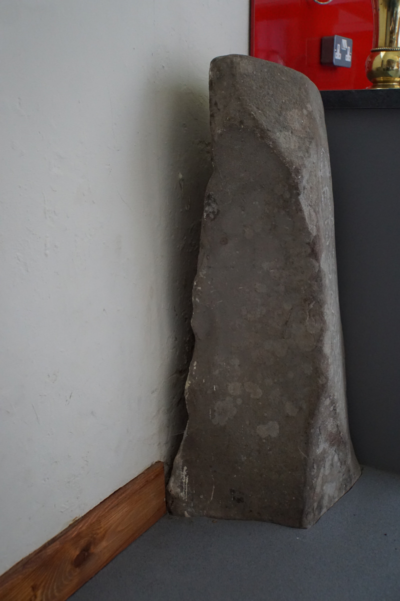 The Roman Stone side view.